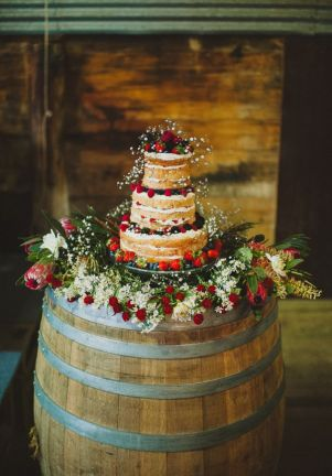 rustic-naked-wedding-cake-on-wine-barrel